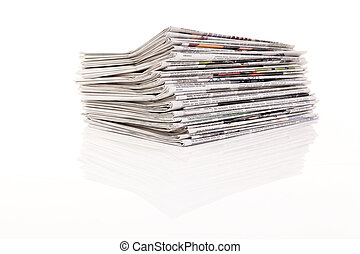 Stacks of old newspapers - Old newspapers and magazines in a...