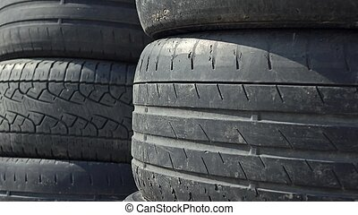 Stacks of old used car tyres. Disposal site