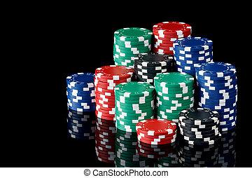 stacks of poker chips over black background