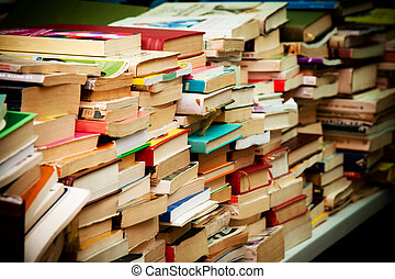 Stacks of second-hand books at market. Collectors' items or...