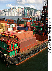 Stacks of shipping containers at a port in Hong Kong