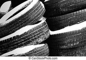 Stacks of Worn Tires in the Snow