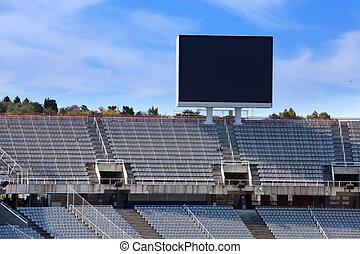 stadium. Board above empty tribunes.