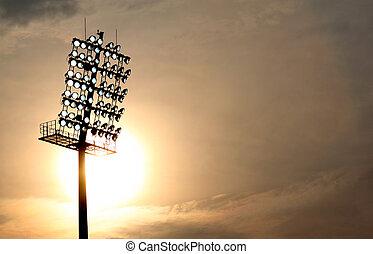 Stadium Floodlight at setting sun with selective focus
