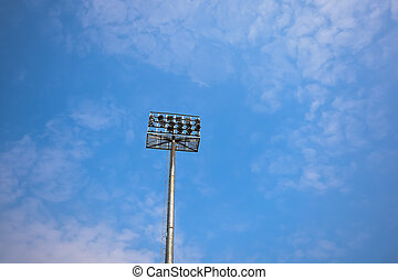 Stadium light over blue sky