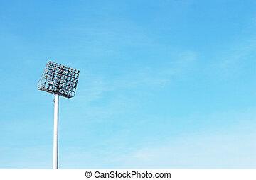 Stadium light pole in the sky.