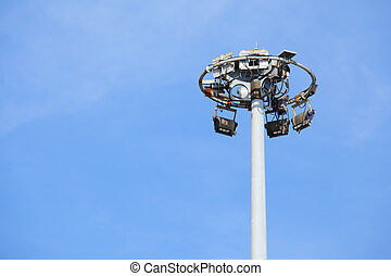Stadium light with blue sky