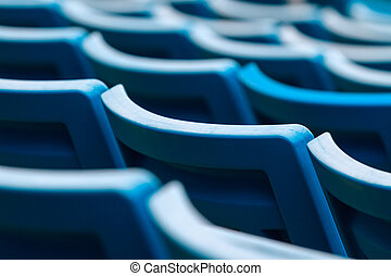 Stadium seating - Seating rows in a stadium with weathered...