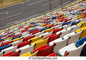 Stadium Seats - Rows of colored seats at an outdoor venue