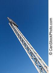 stadium spotlight with blue sky