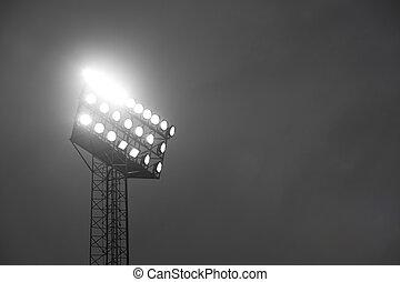 Stadium spotlights lite at night.