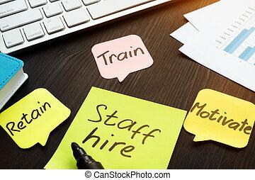 Staff hire, train, motivate and retain written on a memo ...