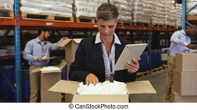 Staff in a warehouse packing boxes for delivery 4k