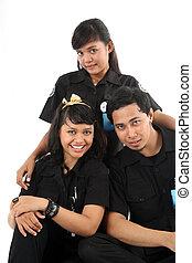 staff in uniform posing