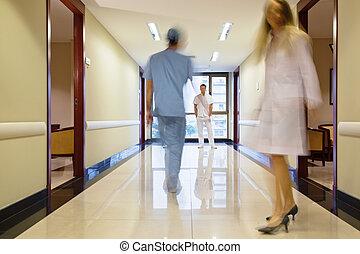 Staff walking in hallway - Staff walking through the hallway...