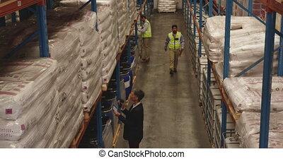 Staff working in a warehouse storage bay 4k
