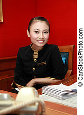 staff working in the office smiling