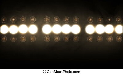 Stage lights. Close-up. The projectors brightly shine and turn on and off.Floodlight Lights Flashing Wall .
