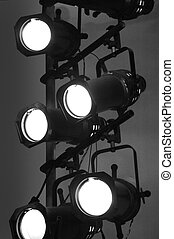 Stage Lights - Stage lights on a vertical rig in black and...