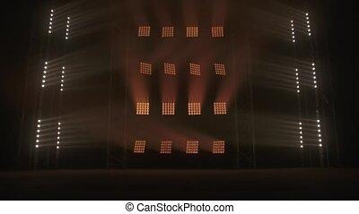 Stage lights flashing at podium