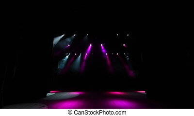 Stage lights flashing at podium. The stage of a theater with pink spotlights.