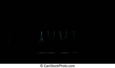 Stage lights. Projectors in the dark. Spotlight strike through the darkness