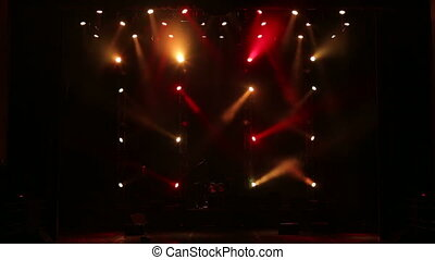 Stage lights and smoke. Colored lights on an empty concert stage with smoke.