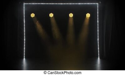 Stage yellow lights shining at studio. Lighting equipment. Lighting effects. The concept of a holiday, show or theatrical performance