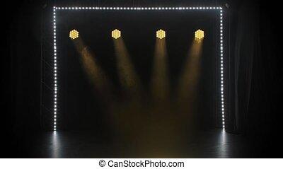 Stage yellow lights shining at studio. Lighting equipment. ...
