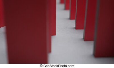 Cause and reason connection. Crisis idea. Business to business. Red domino. Falling red color dominos. Causality background. Conceptual. Business slowing down. Bankruptcy background