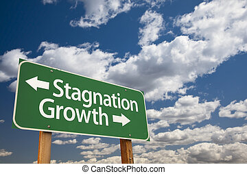 Stagnation or Growth Green Road Sign Over Clouds and Sky -...
