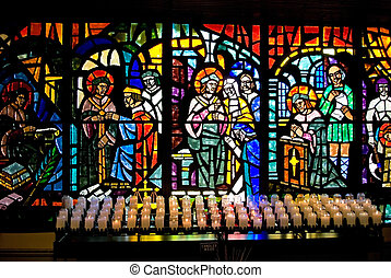 Stained Glass and Candles - Stained glass windows and votive...