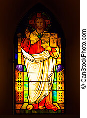 Stained glass depicting Jesus Christ in the church.