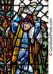 Stained glass fragment depicting Moses carrying tablets with Ten Commandments