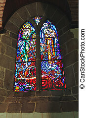 Stained glass In the abbey church of Mont Saint Michel. Normandy, France