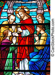 Stained glass window, in 19th century (St. Mary's built 1875 - 1899) church, of Jesus, Matthew, Mark, Luke, and John during Last Supper Wide, dark bars across image are from reinforcing rods added to the outside of the window back in the mid-20th century. Very common on older stained glass as it ...