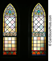 Pair of backlit gothic stained glass windows. Circa 1880