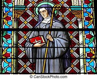 Stained Glass Window - Stained glass window of a Saint in a...