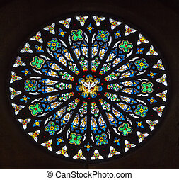 stained-glass window with symmetrical decorative geometric patterns