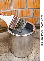 Stained grey color paint brush over can