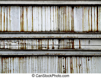 Stained rusty metal wall