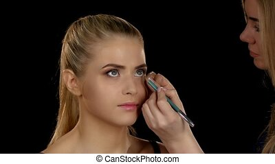 Staining pencil inner eyelid eyes. Makeup. Closeup -...