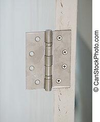 stainless door hinges on a door
