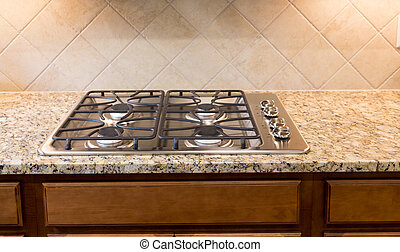 Stainless Gas Cooktop on Granite Countertop