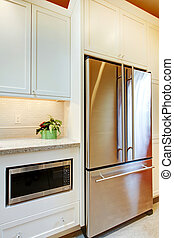 Stainless steal refridgirator with microwave.
