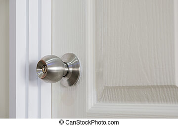 Closeup of spherical of stainless steel door knob.