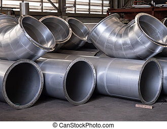 Stainless steel ducting at an industrial workshop.