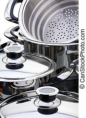 Stainless steel pans - A fragment of a still life of chrome-...