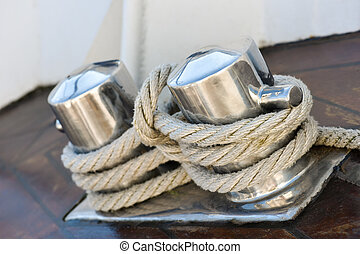 Stainless steel pillar with rope on boat