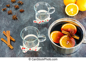 Stainless steel pot with Mulled Wine and Glasses
